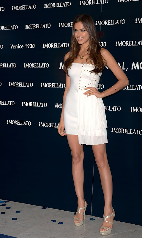 Irina Shayk posing in short white dress