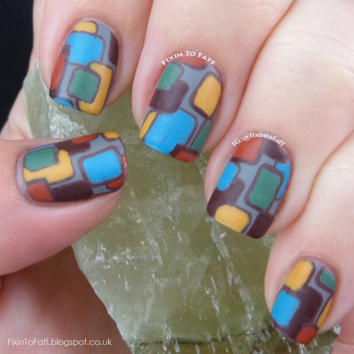 Rectangular stamped nail art in a 1970s-inspired color scheme and pattern.