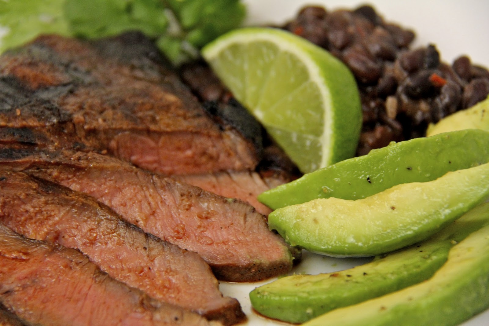 Carne Asada w/ Chorizo Black Beans & Honey-Lime Avocados