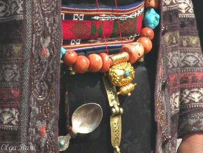 Gold amulet container attached to coral and turquoise necklace