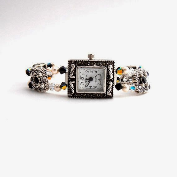 https://www.etsy.com/listing/79820300/crystal-watch-black-and-cream-marcasite?ref=favs_view_4