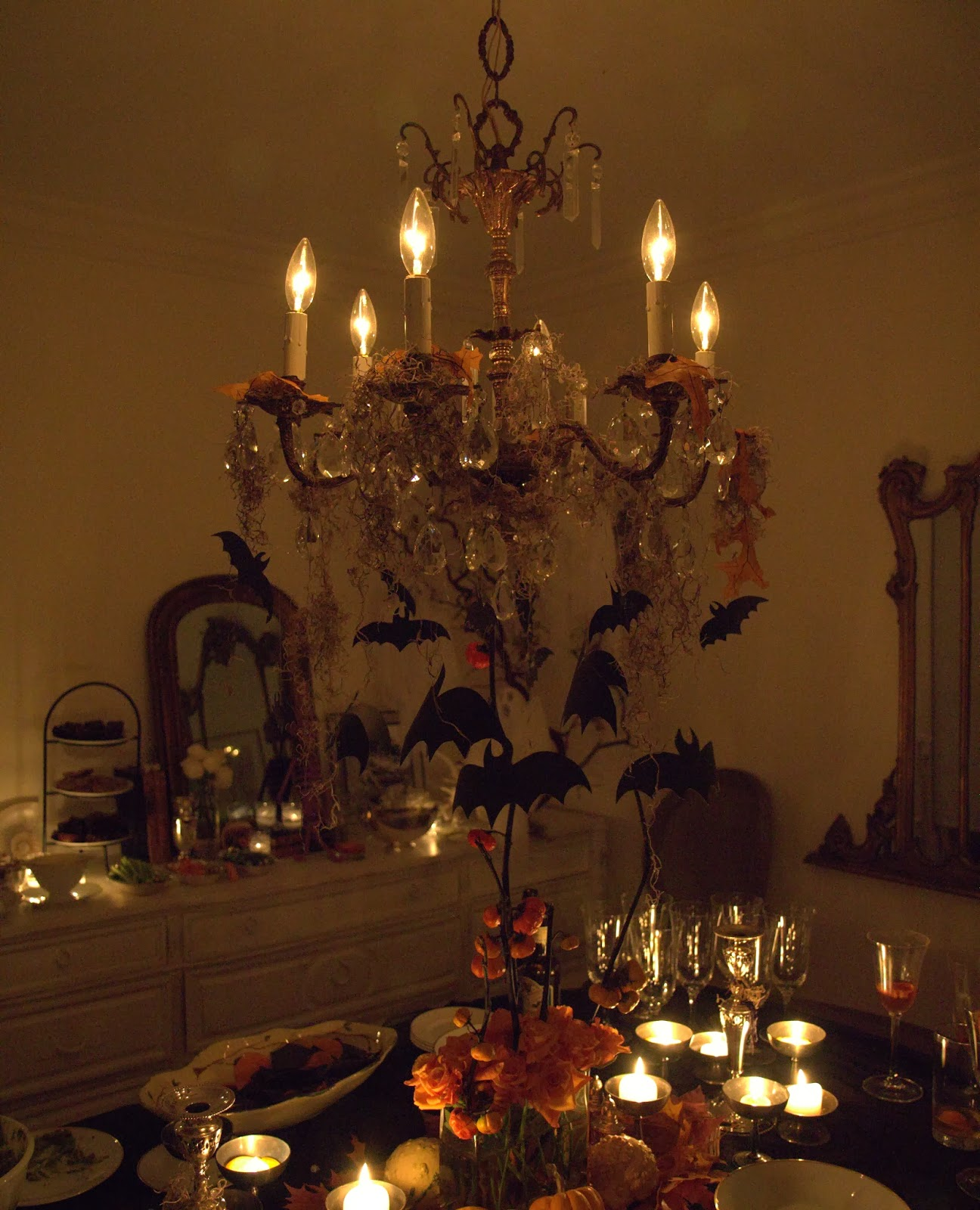 Dining Room Table and Chandelier with bats - Spooky Glam Halloween Party