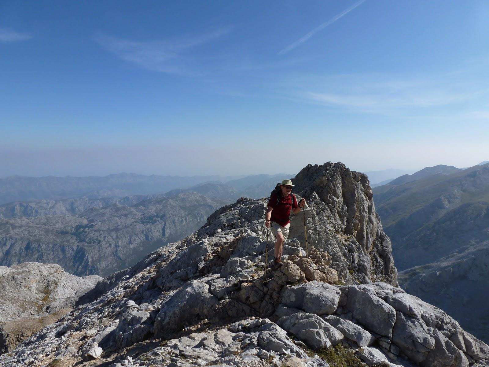 David crossing a steep arete
