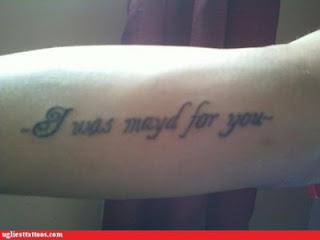misspelled tattoo on the forearm: I was mayd for you