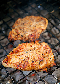 Cajun Caesar Grilled Chicken Recipe - 3 ingredient marinade! Caesar dressing, cajun seasoning and lemon juice. SO simple and super delicious! Whisk up marinade in the morning and let the chicken hang out in the fridge all day. Grill up for a quick and delicious dinner.