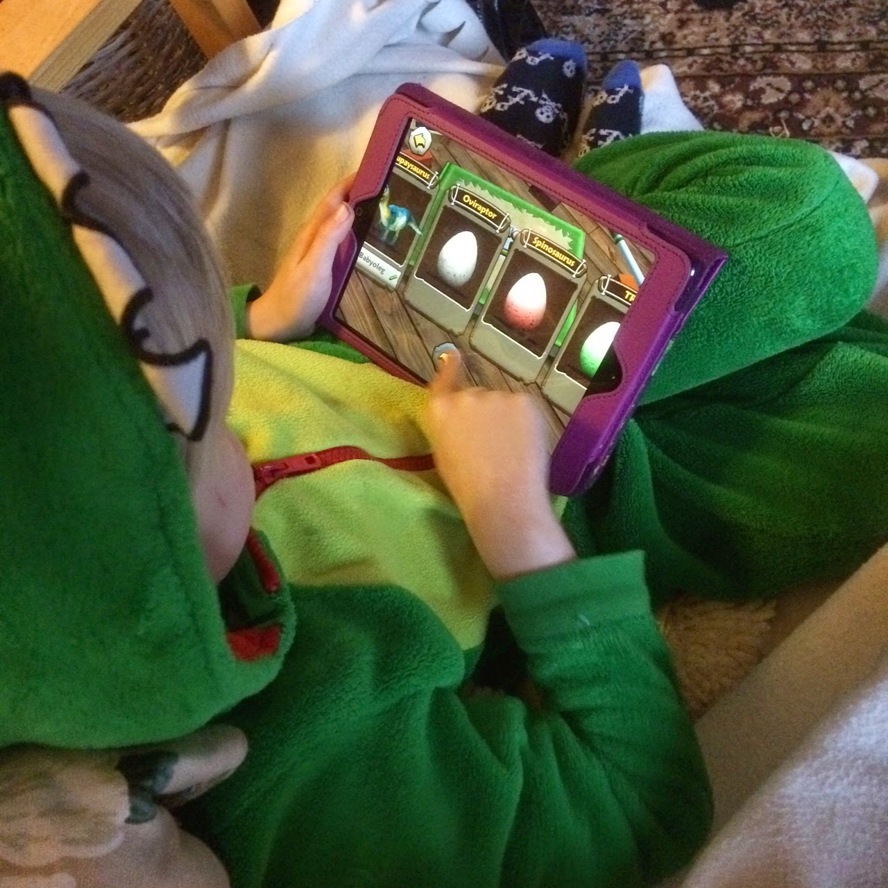 child playing tablet iPad