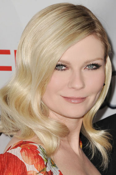 Kirsten Dunst plays up her