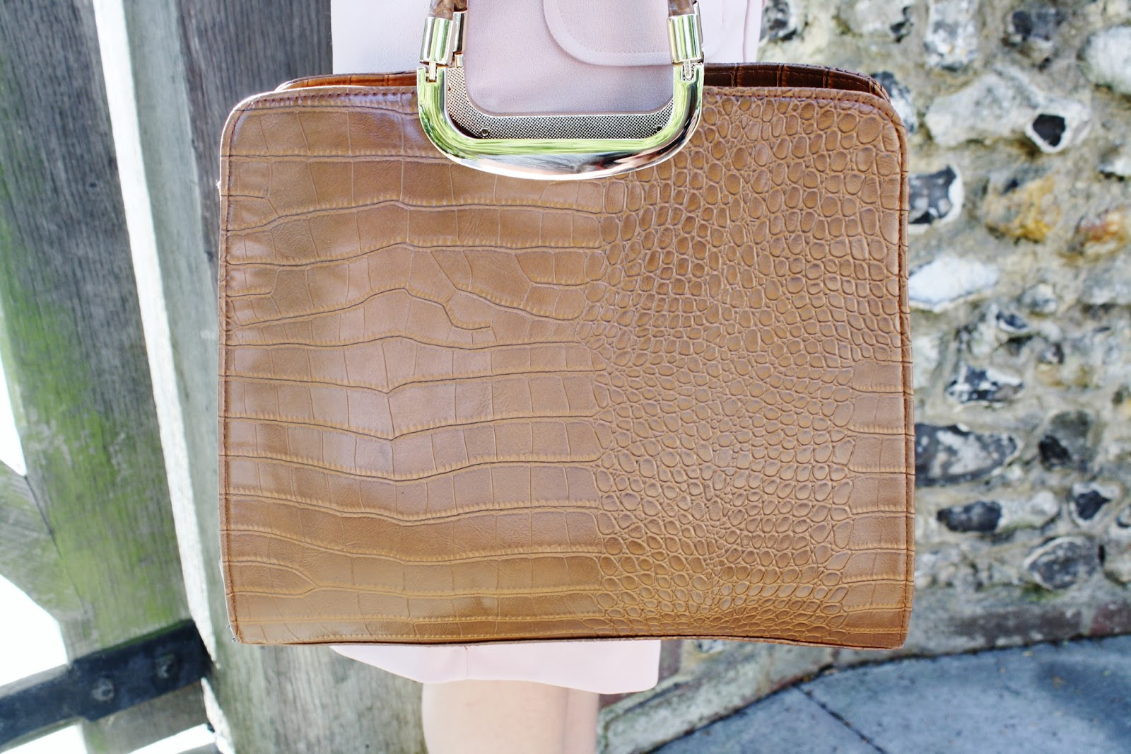 close up of tan moc croc printed handbag from dorothy perkins