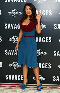 Salma Hayek waves to fans during  Savages Photocall in London
