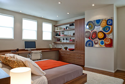 in front of the bed is contemporary cells and wood furniture in the corner for private office
