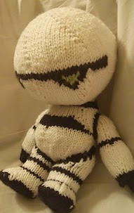 http://www.ravelry.com/patterns/library/marvin-the-paranoid-android-plushie
