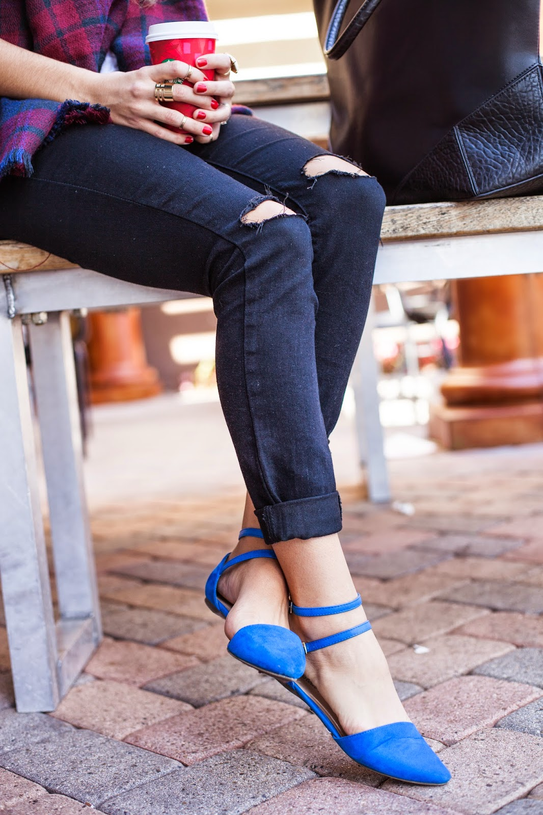 ripped black jeans and blue flats