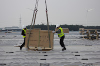 Workers Place the Pallets
