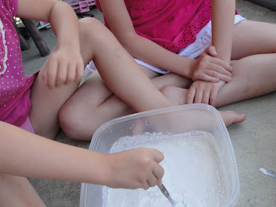 child mixing the plaster