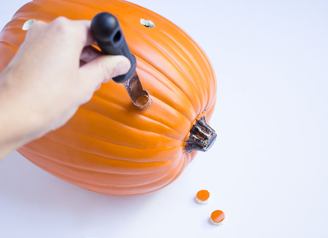 Use an apple corer to make holes in craft pumpkins!