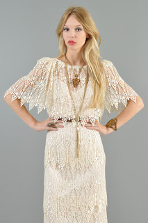 Vintage 1970's cream colored crochet lace dress with mini cape-like sleeves.