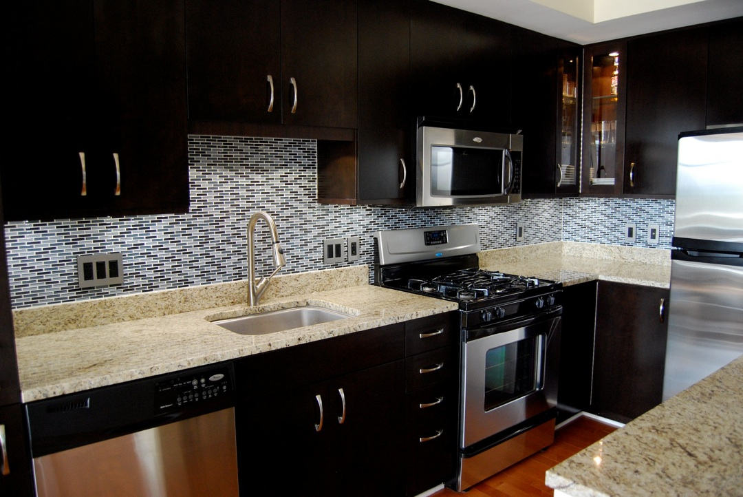 dark cabinets with tile backsplash the interior design