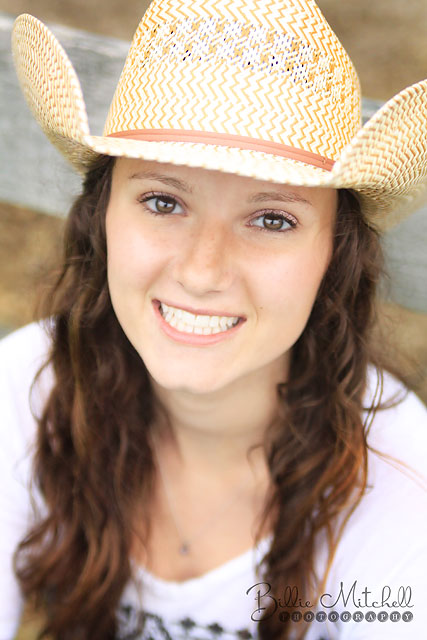 Senior picture in cowboy hat.