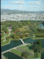 Photo of fort Goryokaku from Goryokaku tower with city and mountains in the background at Hakodate