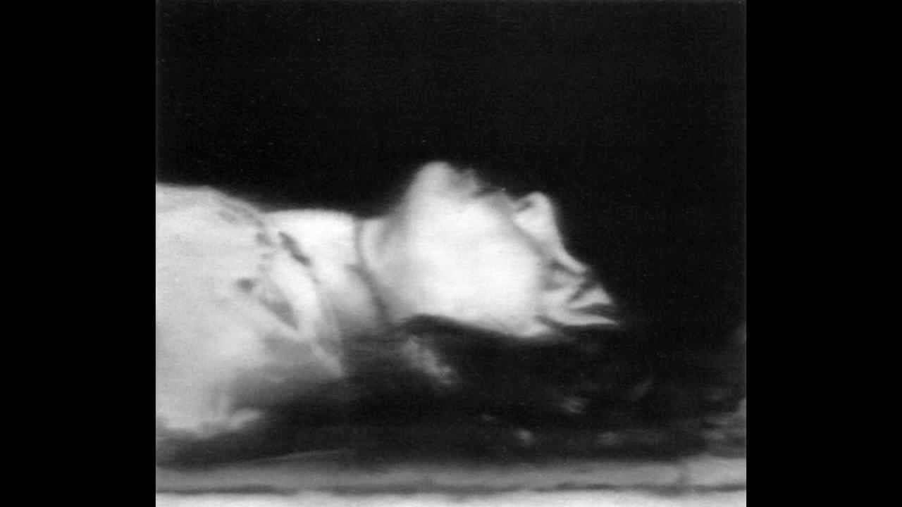 The black and white corpse of Ulrike Meinhof painted by Gerhard Richter