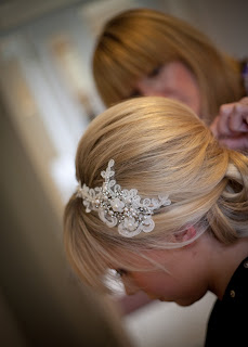 sixties influenced hairstyle for a bride. Blonde bouffant style with lace and jewelled hair band
