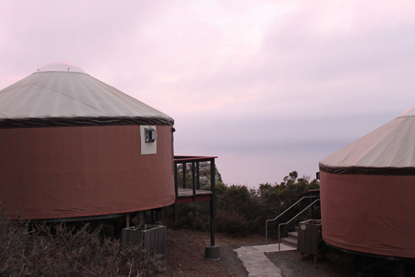 Ocean-view yurts at sunset at Treebones, Big Sur