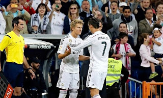 Real Madrid's Martin Odegaard makes debut at 16 in hammering of Getafe