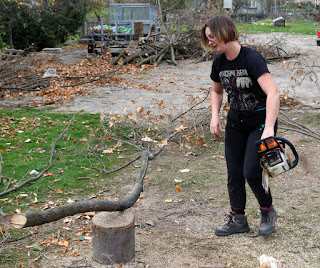 A wearing her Machine Head t shirt to chainsaw