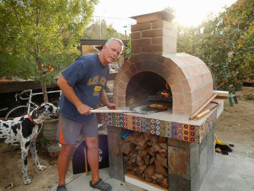 Brown Wood Fired Brick Pizza Oven And A Great Big Dog