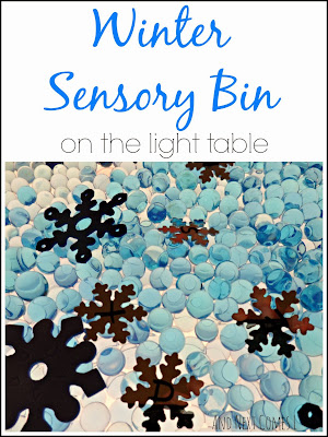 Winter themed sensory bin for the light table with water beads and alphabet snowflakes from And Next Comes L