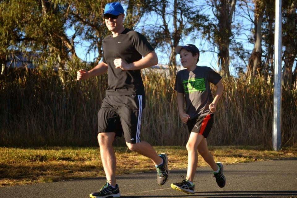 Our 8 Year Old Grandson Running A PB At Parkrun With His Dad
