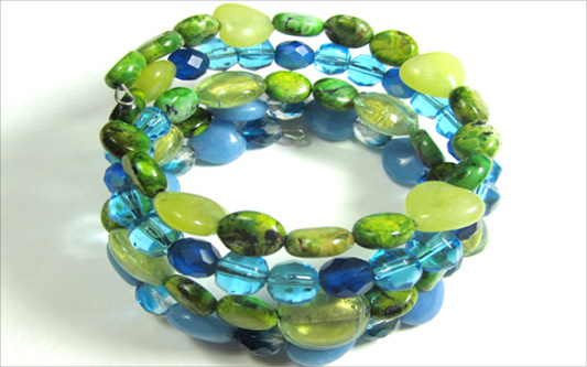Beaded memory wire bracelet with semi precious beads in green and blue