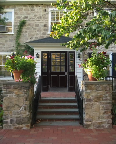 Black Front Door on Against A Stone Exterior  These Black Doors Imbue A Welcoming Sense