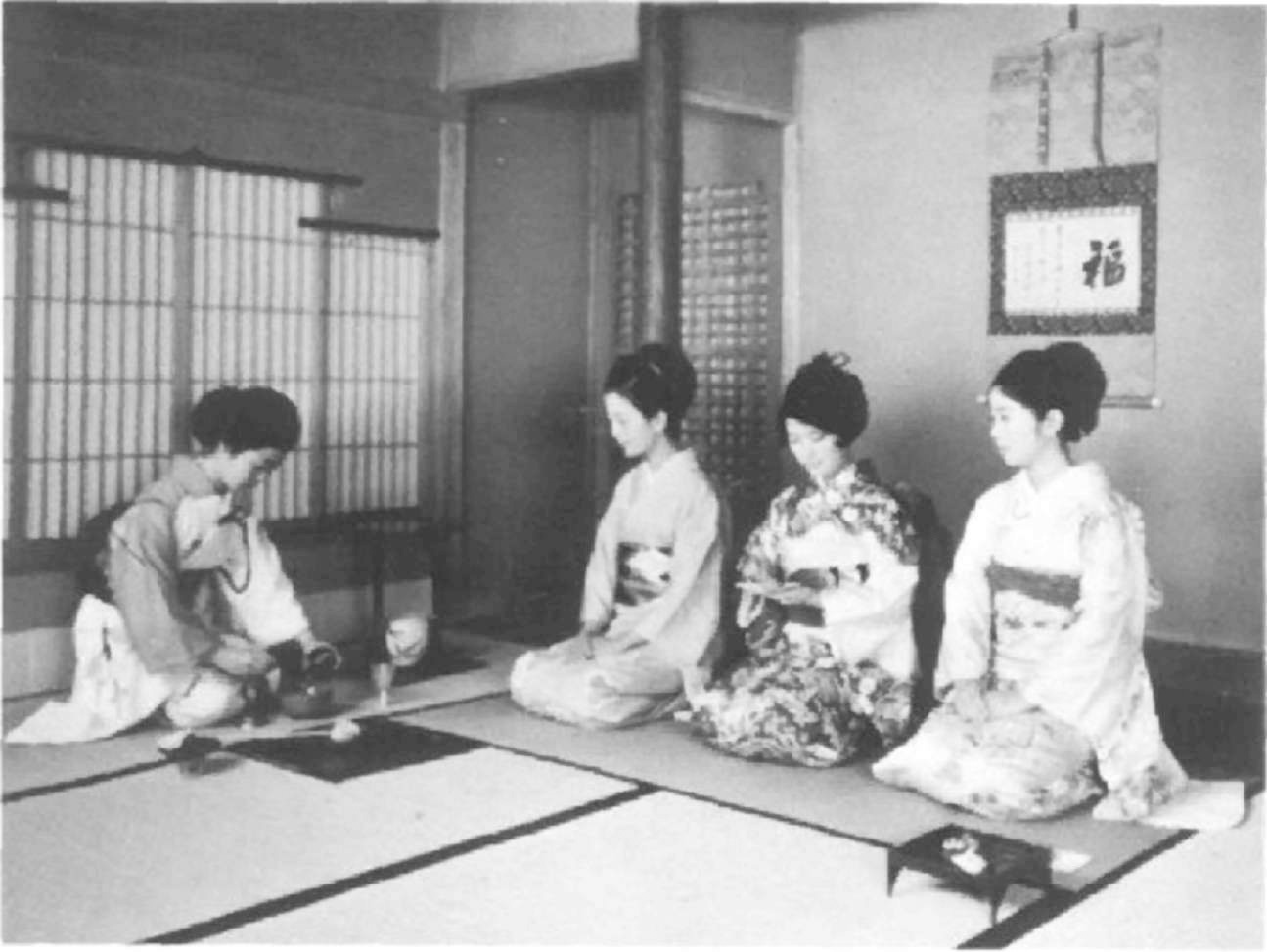 Host and guests at a tea ceremony. title=