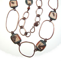 Copper Rings and Scroddled Clay Necklace
