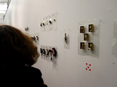 View of a gallery displaying art brooches.