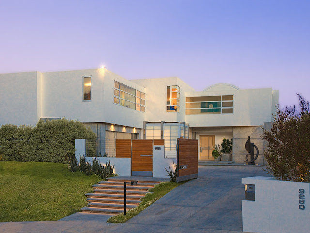 Picture of modern mansion as seen from the street at sunset