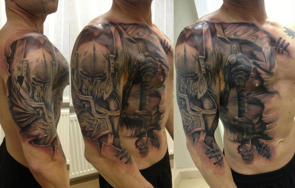 Home » Full Body » Knight with axe tattoo on chest and arms