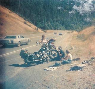Changing tire on vintage Harley Panhead motorcycle