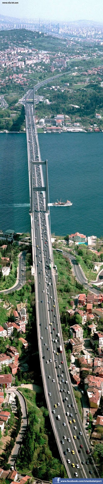 Bosphorus Bridge Istanbul. It is 1,510 m (4,954 ft) long with a deck width of 39 m (128 ft). The distance between the towers (main span) is 1,074 m (3,524 ft) and their height over road level is 105 m (344 ft)