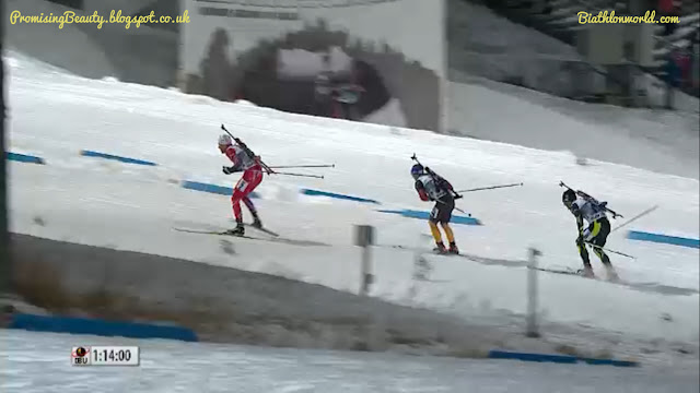 Male biathletes Birkeland, Fourcade and Schemp racing for the finish at Ostersund, Sweden during the mixed relay in 2014. A wintersport with lots of snow, picture from biathlonworld.com