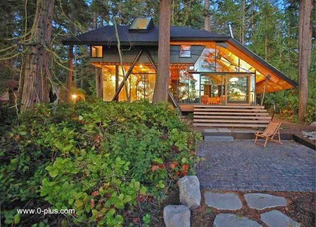 Cabaña con abundantes vidrios diseño contemporáneo