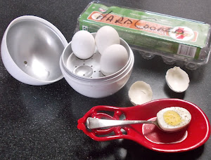 No more peeling eggs! Microwave cooker makes them scoopable.  Thanks, Betty, and Zabar's!
