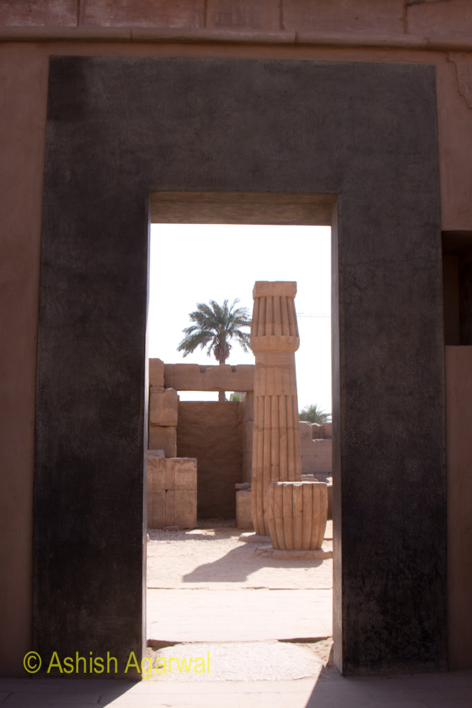 Open doorway inside the Karnak temple leading to more structures beyond