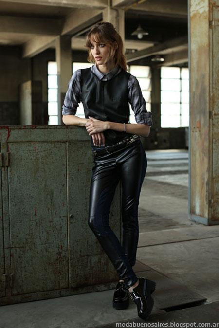 Pantalones de cuero, cjalecos y camisas a cuadros incluidos en la colección de moda argentina Tucci otoño invierno 2014.