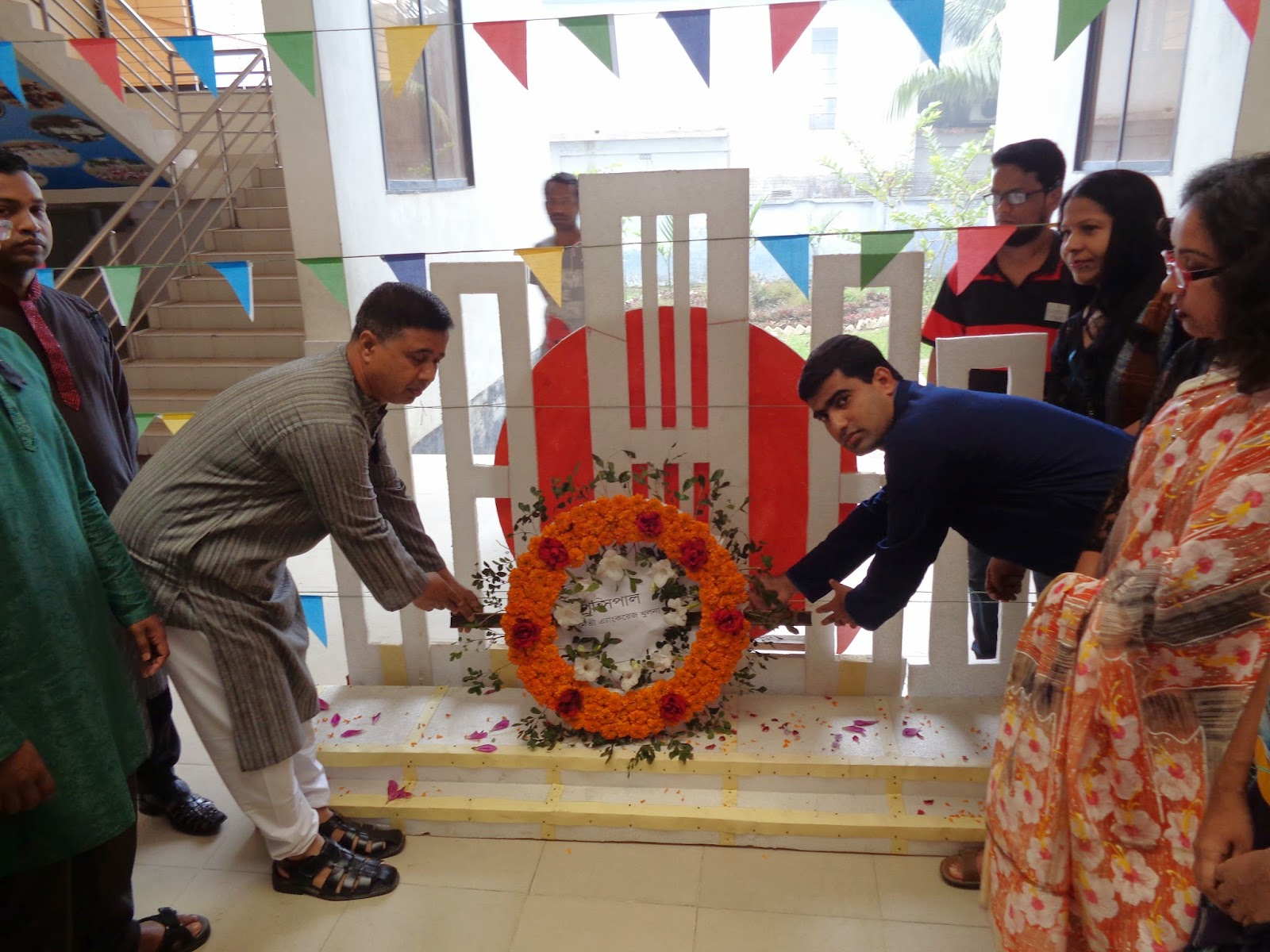 b n english school college khulna international mother language later the monument was opened for the students to offer flowers great respect and everybody took part in a special prayer seeking eternal peace for the