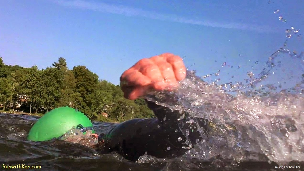 Up-close action photo of open water swimming at the Greendale Triathlon in Worcester, MA.  Sports photography from Inside the Pack by Ken Skier, The Swimming Photographer. (RunwithKen.com)