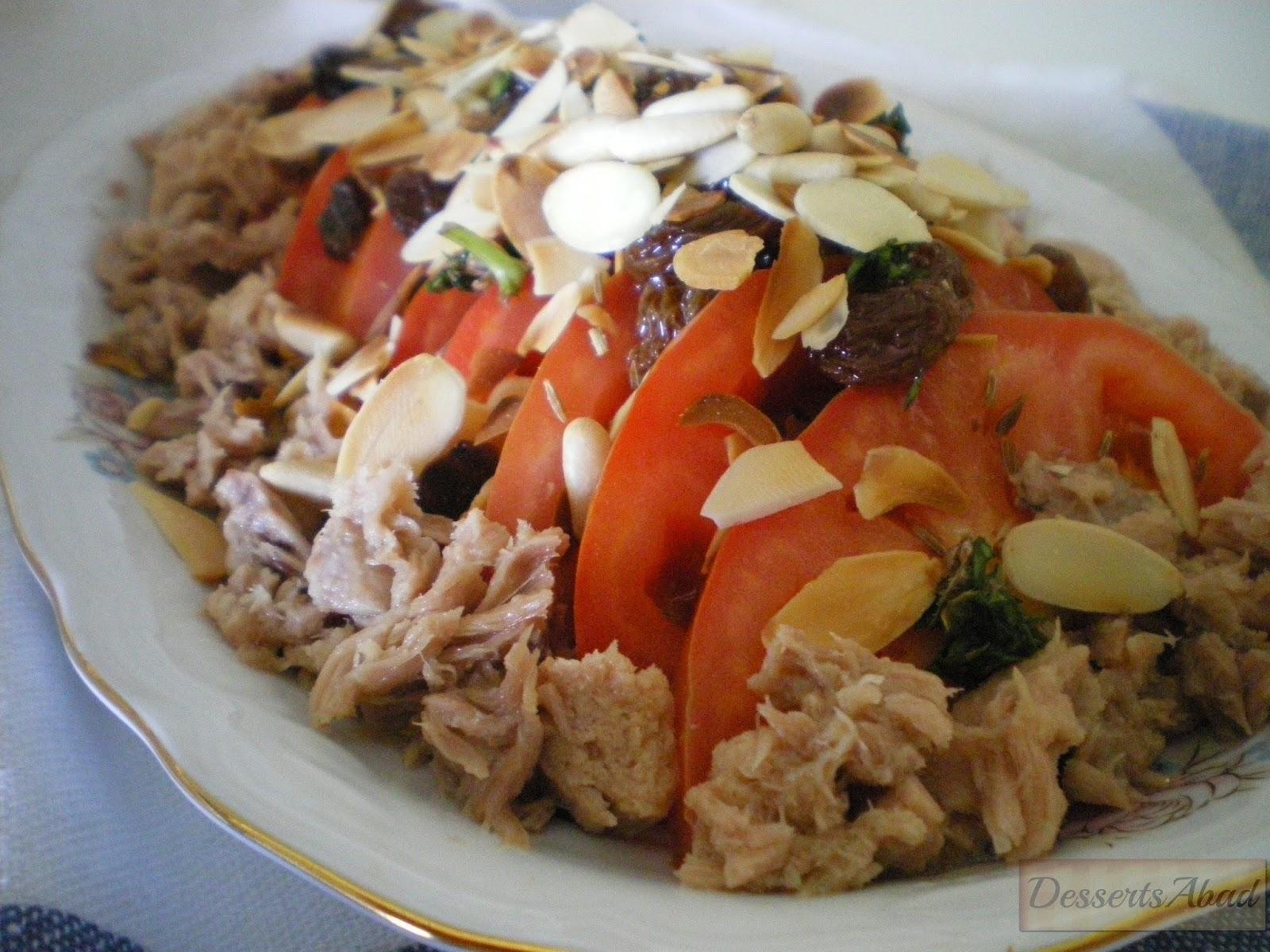 Ensalada de tomates con vinagreta de pasas