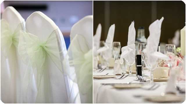 green bow ties on the back of white chairs at wedding and top table set up