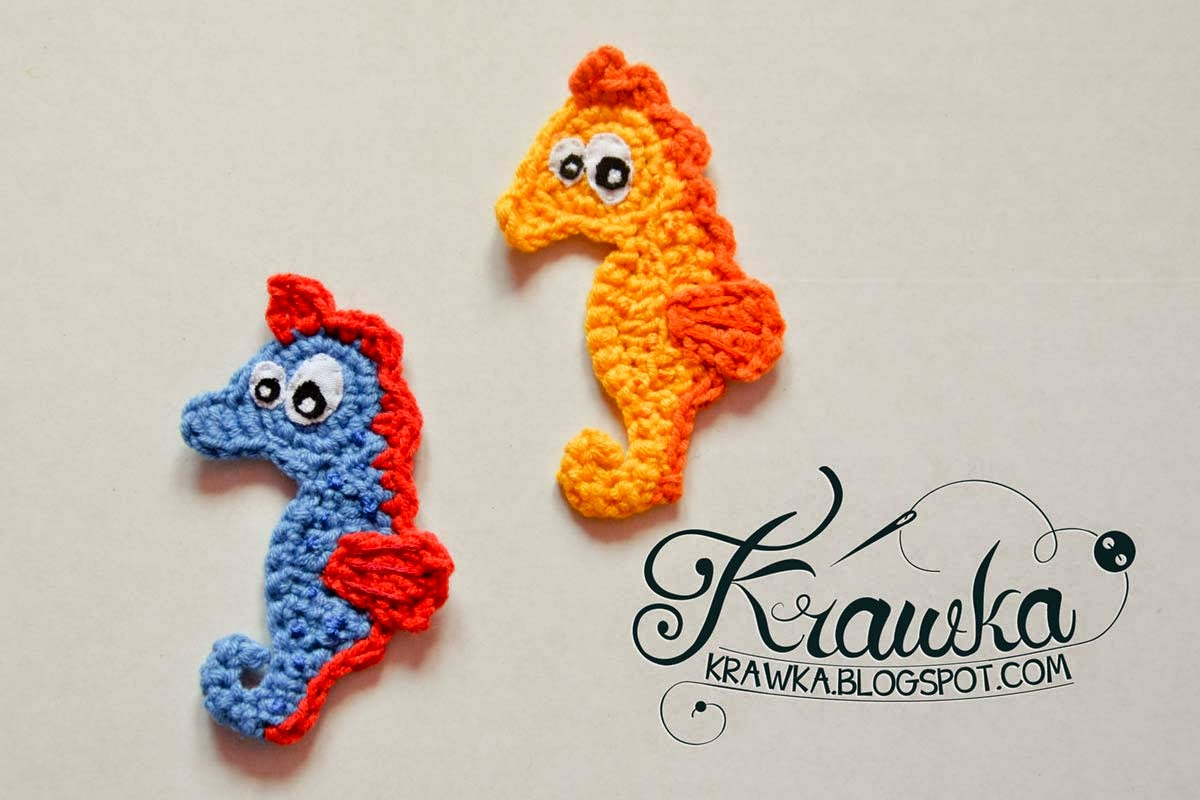 Crochet amigurumi applications/stripes blue sea horse with red fins and yellow with orange fins.